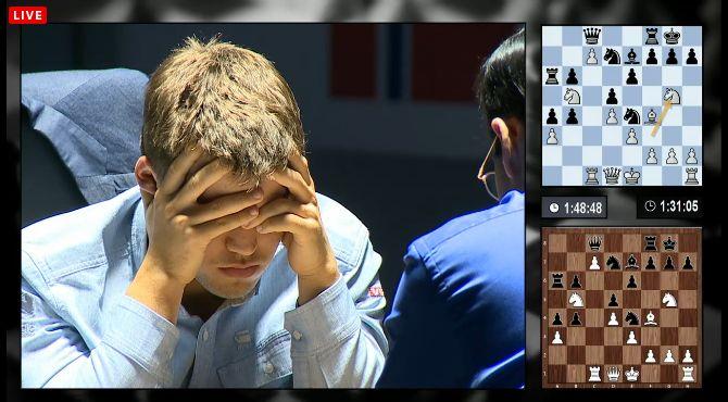 Carlsen réfléchit 3eme partie du match