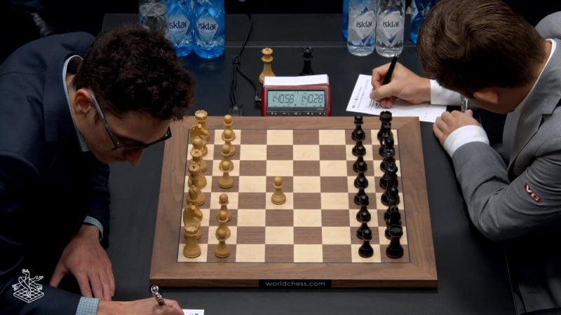 Championnat du Monde d'échecs 2018 partie 8 Caruana-Carlsen premier coup