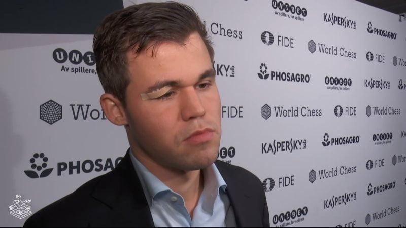 championnat-monde-echecs-2018-partie-9-proposition-nulleChampionnat du Monde d'échecs 2018 partie 9 Magnus Carlsen pansement